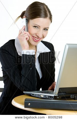 telephoning businesswoman with a laptop
