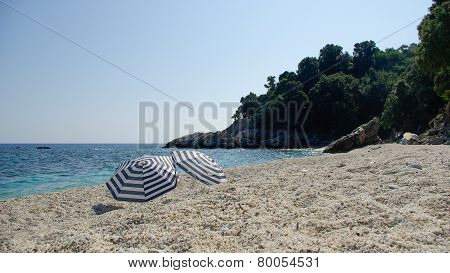 Two umbrellas (parasols) on the beach