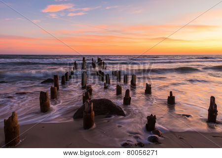 Wooden Breakwaters And Sea