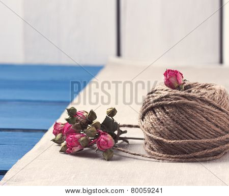 Ball of twine with  dried roses bouquet