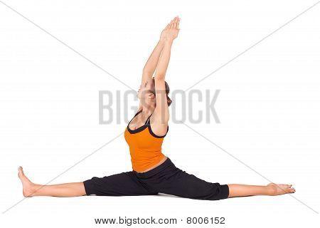 Fit Woman Practicing Monkey God Yoga Pose