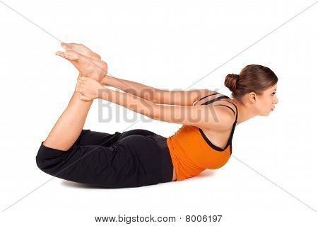 Woman Practicing Yoga Exercise Called Bow Pose