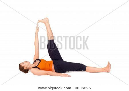 Woman Practicing Reclining Big Toe Yoga Pose