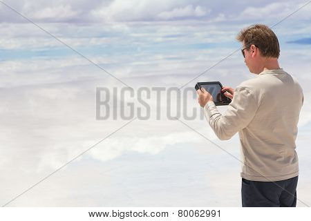 Man working on a digital tablet
