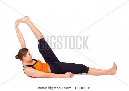 Woman Practicing Reclining Big Toe Yoga Pose