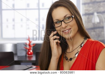 Closeup portrait of happy businesswoman on mobilephone.