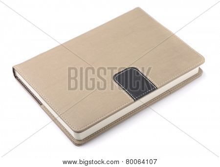 Closed hardcover notebook isolated on white
