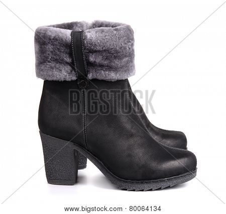 Black leather winter boots isolated on white
