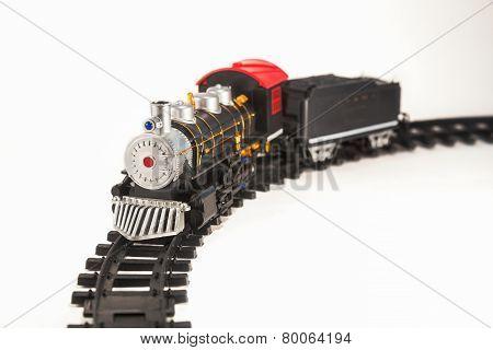 Toy Steam Locomotive On Rails