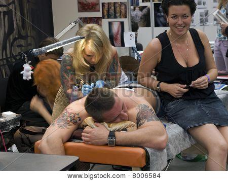Tattoo artist at work at St.Petersburg Tattoo Festival