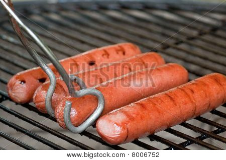 Hot Dogs And Tongs