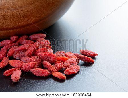 Heap of Dry Goji Berries on the Dark Table. Healthy Diet