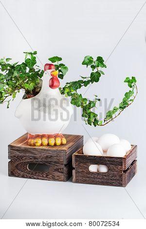 sculpture of hen near  bio eggs in box