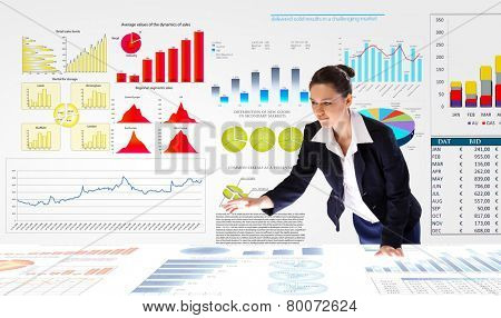 Young businesswoman and statistics information on table