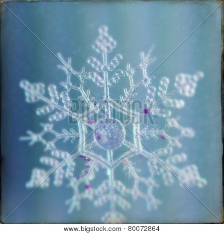 An Instagram filtered image of a snowflake