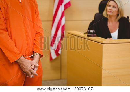 Judge looking the condemned prisoner in the court room