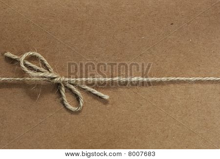 String Tied On Recycled Paper