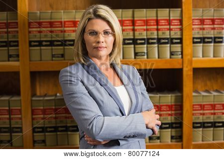 Lawyer looking at camera in law library at the university