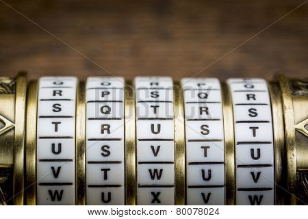trust word as a password to combination puzzle box with rings of letters
