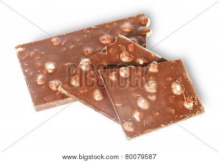 Pieces Of Dark Chocolate With Hazelnuts