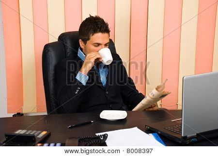 Manager Reading News In His Office