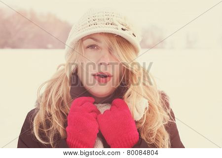 Winter Woman In Snow Photo, Looking And Blows Breath At Camera