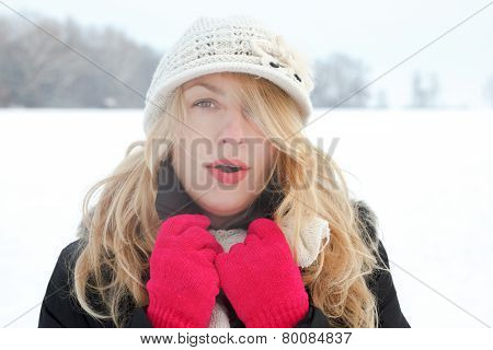 Winter Woman In Snow Photo, Looking And Blows Breath