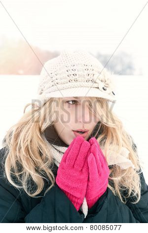 Woman In Snow Photo, Blows Breath To Her Hands