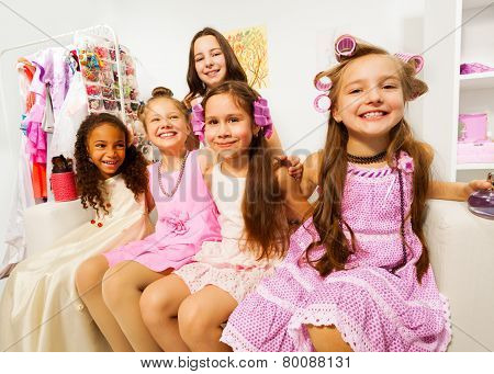 Girls with sitting on white sofa of beauty salon