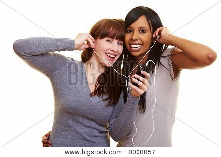 Woman Listening To Music Together
