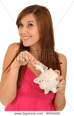 Gorgeous Woman With Piggybank
