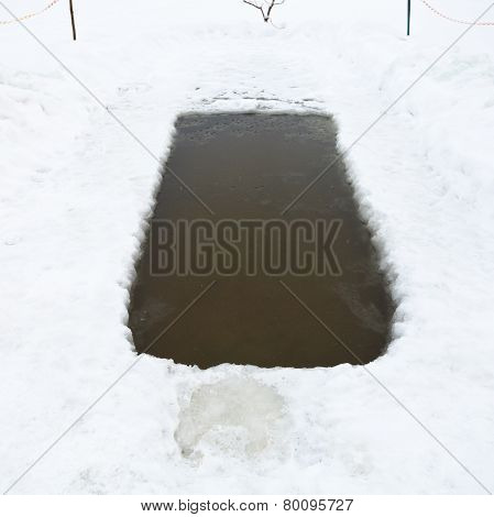 Ice Hole With Frozen Water In Lake In Winter