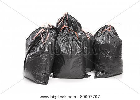 Studio shot of a bunch of garbage bags isolated on white background