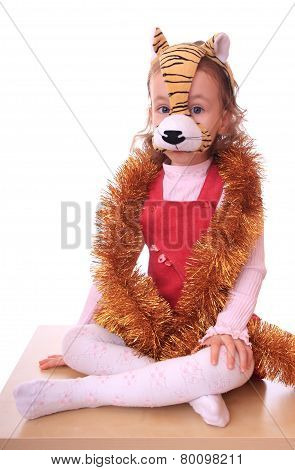 Little girl is in the mask of tiger.