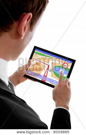 Businessman Holding A Touchpad Pc, Using The Navigation Programme