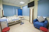 stock photo of health center  - Bed in a private hospital medical center ward room - JPG