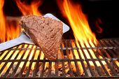 stock photo of flames  - Raw Fillet Steak on the Spatula - JPG