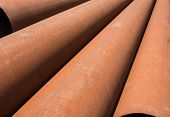 foto of orifice  - Rusty metal pipes stack on the construction site - JPG