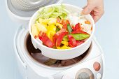 picture of steam  - Cooking fresh sliced vegetables steamed in Multicooker closeup - JPG