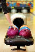 pic of bowling ball  - Colorful Bowling balls in ball return - JPG
