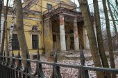 pic of old stone fence  - main entrance of the old dilapidated building with a fence - JPG