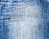 stock photo of indigo  - Texture of threadbare denim of indigo color - JPG