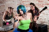 picture of groupies  - Young all girl punk rock band performs in a warehouse - JPG