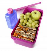 stock photo of lunch box  - Pink lunch box packed with a healthy meal and a bottle of water - JPG