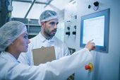 stock photo of food plant  - Food technicians working together in a food processing plant - JPG