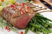 picture of grape  - Herb crusted rack of lamb garnished with asparagus green grapes and pomegranates - JPG