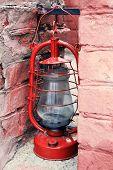 pic of kerosene lamp  - Kerosene lamp on ruined brick wall background - JPG