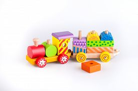 image of train-wheel  - Colorful Colorful wooden toy train isolated on white backgroundwooden toy train isolated on white background - JPG