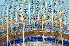image of sufi  - Dome of the beautiful medieval mausoleum of the famous 12th century poet and sufi Khoja Ahmed Yasavi in scaffolding in Turkistan - JPG