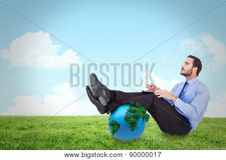 Businessman using tablet against field and sky